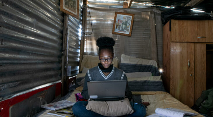 """On 16 August 2020, Sebabatso Nchephe, 18, takes online classes and develops projects on her laptop, at home, a two-roomed shack she shares with her mother and two sisters in Ivory Park, an informal settlement on the outskirts of Johannesburg, South Africa. She must work inside due to fear of the laptop being stolen if she is seen using it outside. In a recent competition, Sebabatso and a group of friends developed two online apps: one to streamline elements of the South African public health system and a second to give vulnerable people access to knowledge about their human rights. Sebabatso says, """"This project has lead me to want to become a lawyer to advocate for my people's rights. I want to be the voice of the people.""""  Sebabatso is a positive, creative and determined young woman who hopes to help change the world – and especially the lives of the poor and vulnerable. Finishing secondary school this year, she has already applied for numerous degrees, knowing that education and opportunity will help change the course of her life. She believes strongly in standing up for the rights of others, especially girls. Sebabatso is a participant in Techno Girl, a UNICEF-supported job shadowing programme for girls from grades 9 to 11. Techno Girl strengthens girls' learning in technical fields (Science, Technology, Engineering and Mathematics, commonly known as STEM), so that they have the training they need to compete for jobs supported by the digital economy in the public and private sectors. Her participation in the programme has prepared her for the workplace while encouraging her to believe in her dreams, informing her decision-making process and supporting her as she's become a role model for positive change within her community.  """"It's a place of shattered dreams,"""" Sebabatso says of Ivory Park, where she lives with her family. """"You're born here, you live here, you quit school, get a boyfriend and then get pregnant. A lot of girls don't complet"""